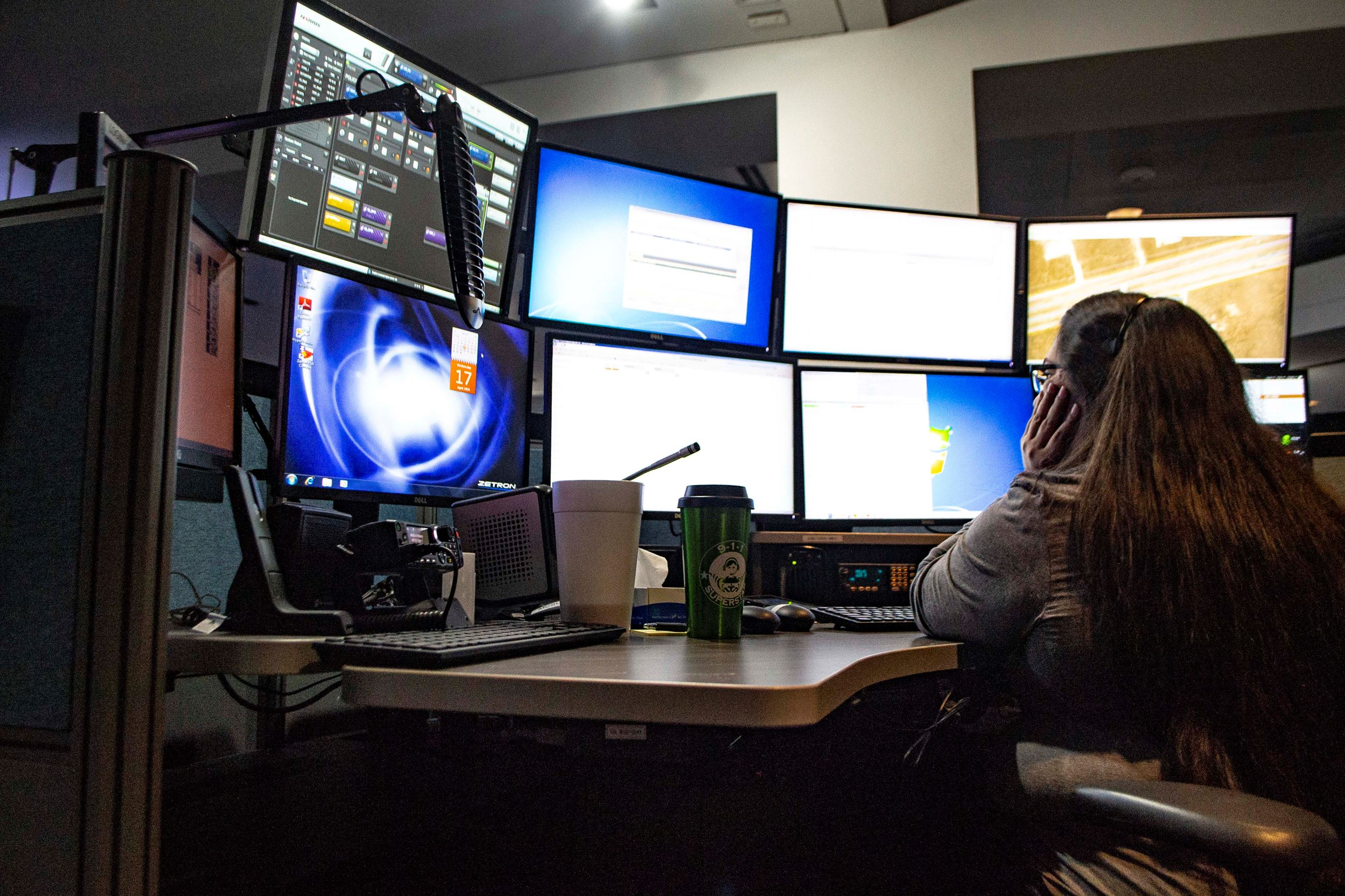 911 Dispatcher sitting in front of computers
